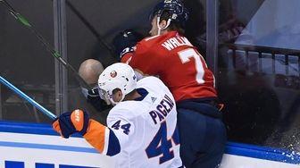New York Islanders center Jean-Gabriel Pageau (44) checks