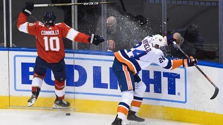 Panthers right wing Brett Connolly checks Islanders defenseman