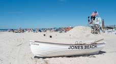 Beachgoers enjoy a day at Jones Beach in
