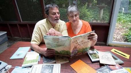Arthur Dobrin and his wife, Lyn, look over