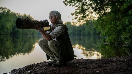 Nature photographer and author Vicki Jauron crouches to