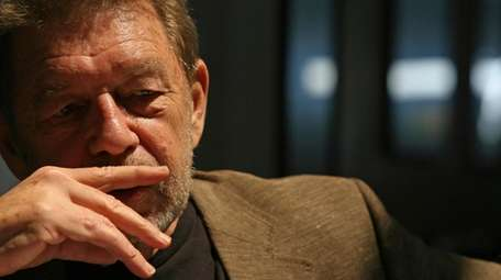 Pete Hamill responds during an interview at the