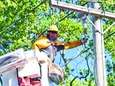 PSEG workers work on restoring power in front