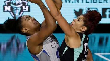 Liberty center Amanda Zahui B., right, blocks a