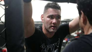 Chris Weidman receives instruction from trainer Ray Longo