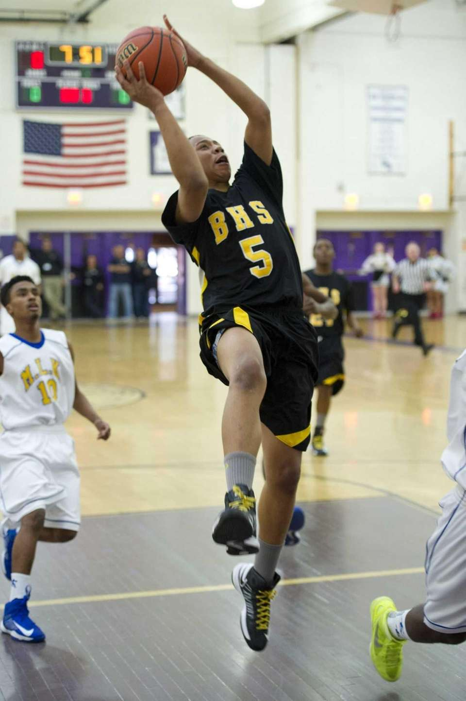 Tylik Furman of Bridgehampton drives to the basket