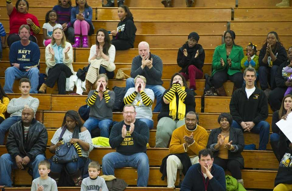 Fans of Bridgehampton watch their team play Martin