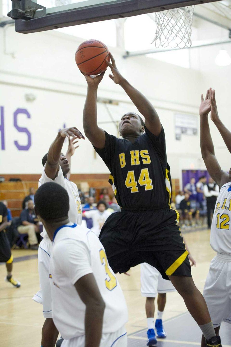 Joshua Lamison of Bridgehampton drives to the basket