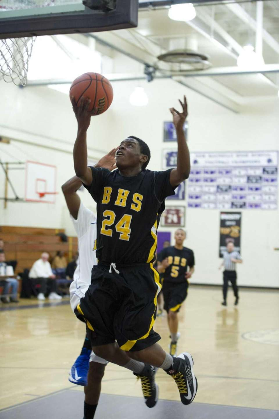 Anajae Lamb of Bridgehampton shoots at the basket