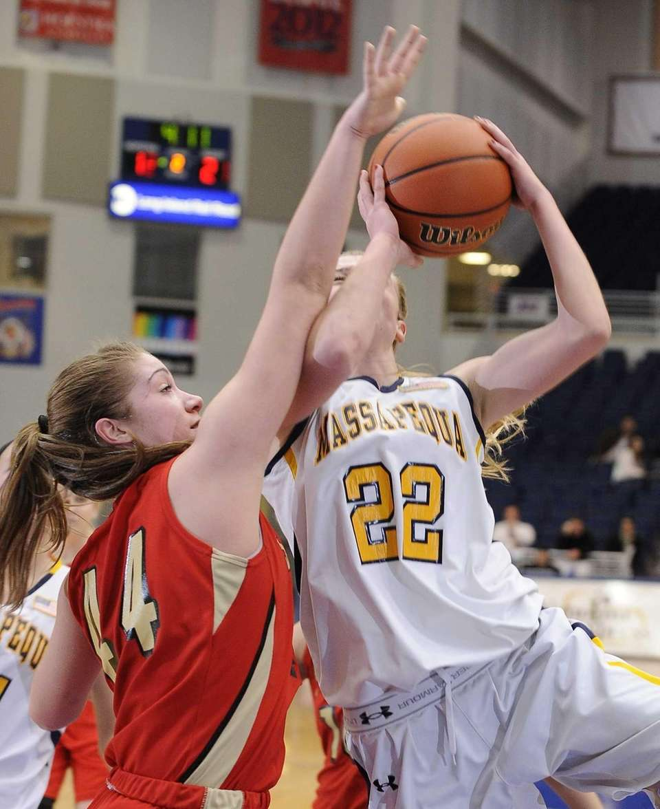 Massapequa's Lauren VanBuren tries to shoot past Sachem