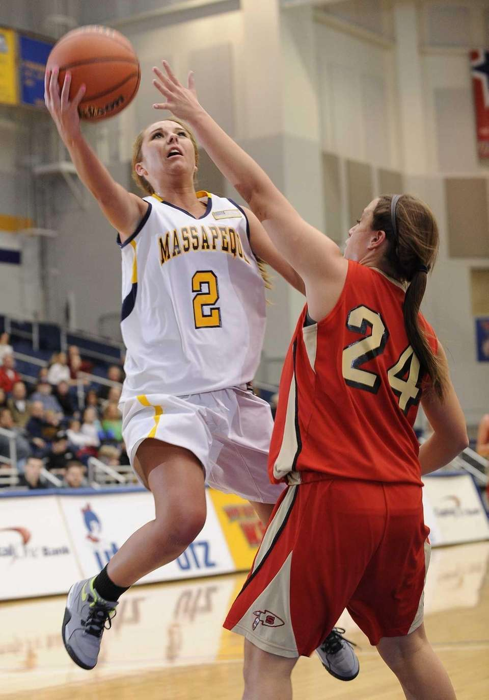 Massapequa's Danielle Doherty sinks a layup as Sachem