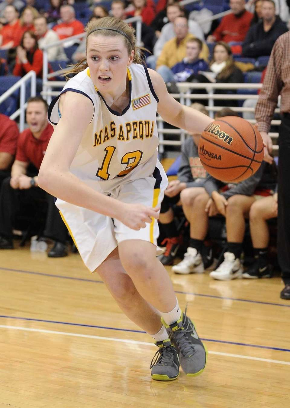 Massapequa's Meghan McCabe drives the ball against Sachem