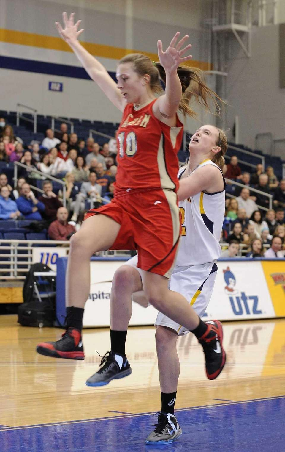 Sachem East's Kathleen Everson defends a layup attempt