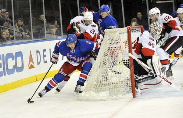 Darroll Powe of the Rangers skates behind the