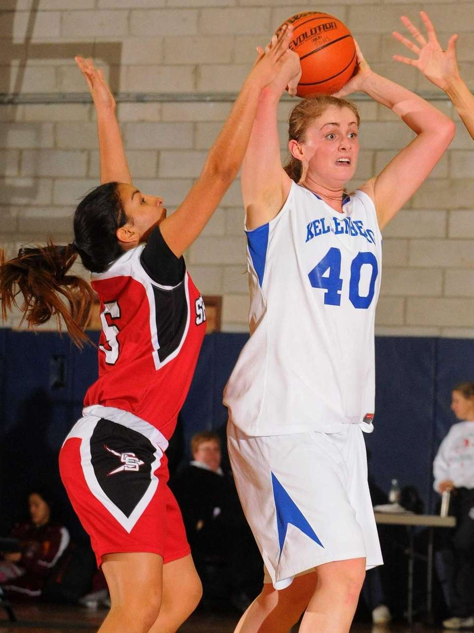 Kellenberg's Candace Belvedere, right, looks to pass away