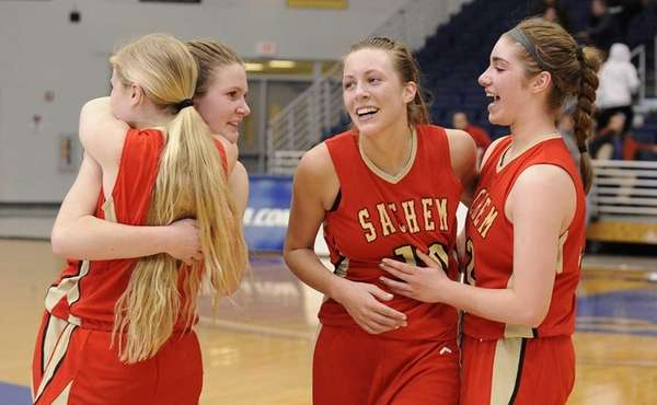 Sachem East players, including Kathleen Everson, facing, celebrate
