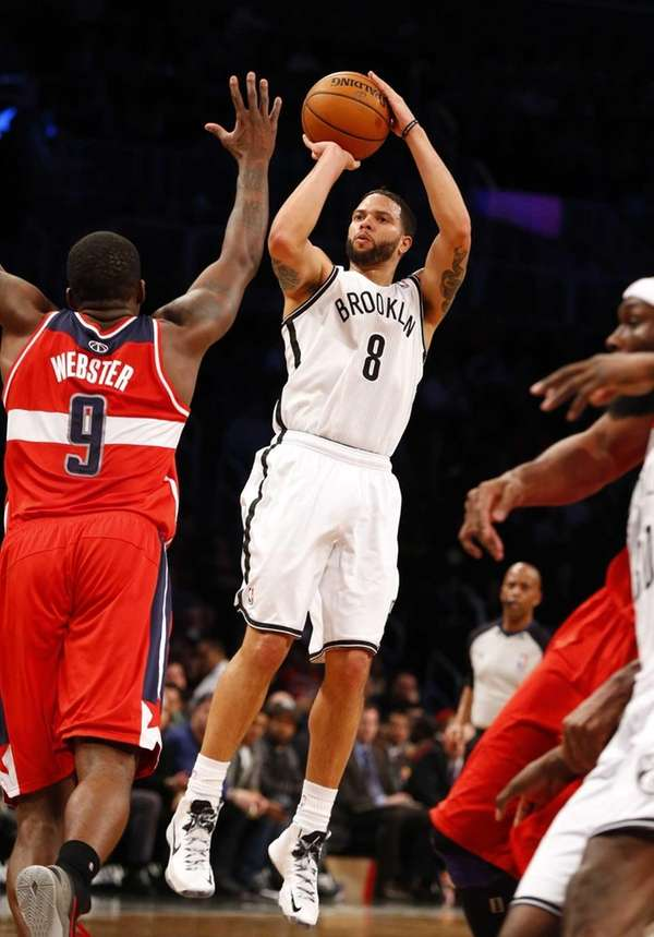 Deron Williams of the Nets shoots a three-point