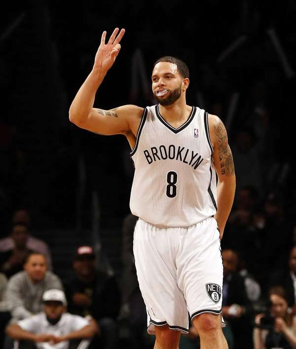 Deron Williams celebrates his record ninth three-point goal