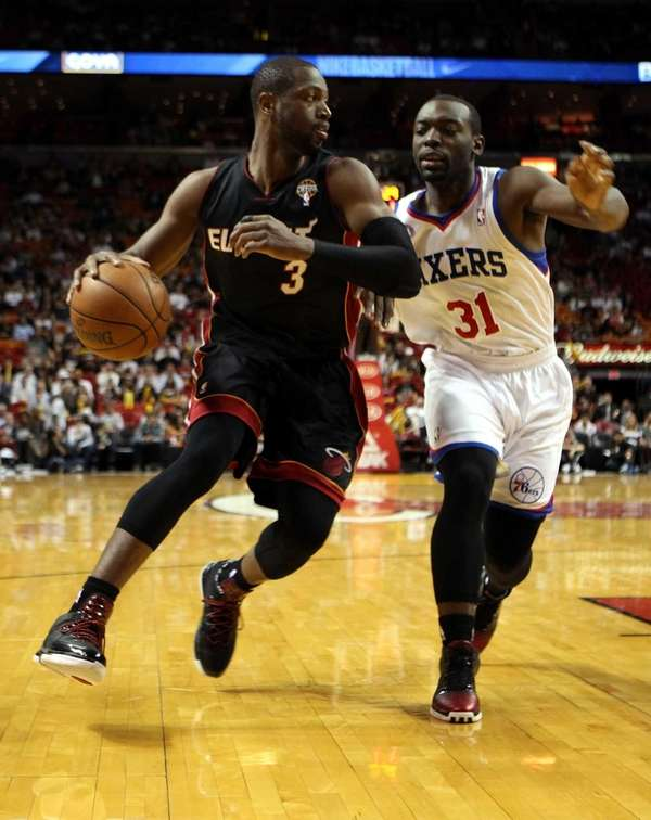 Dwyane Wade of the Miami Heat drives against