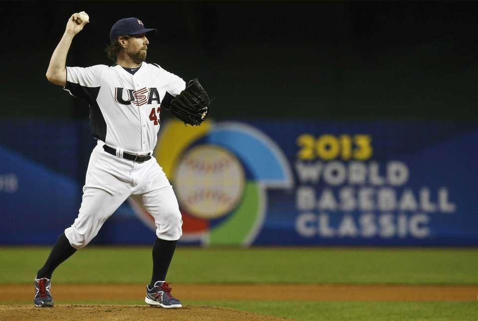 United States' R.A. Dickey attempts a pickoff throw
