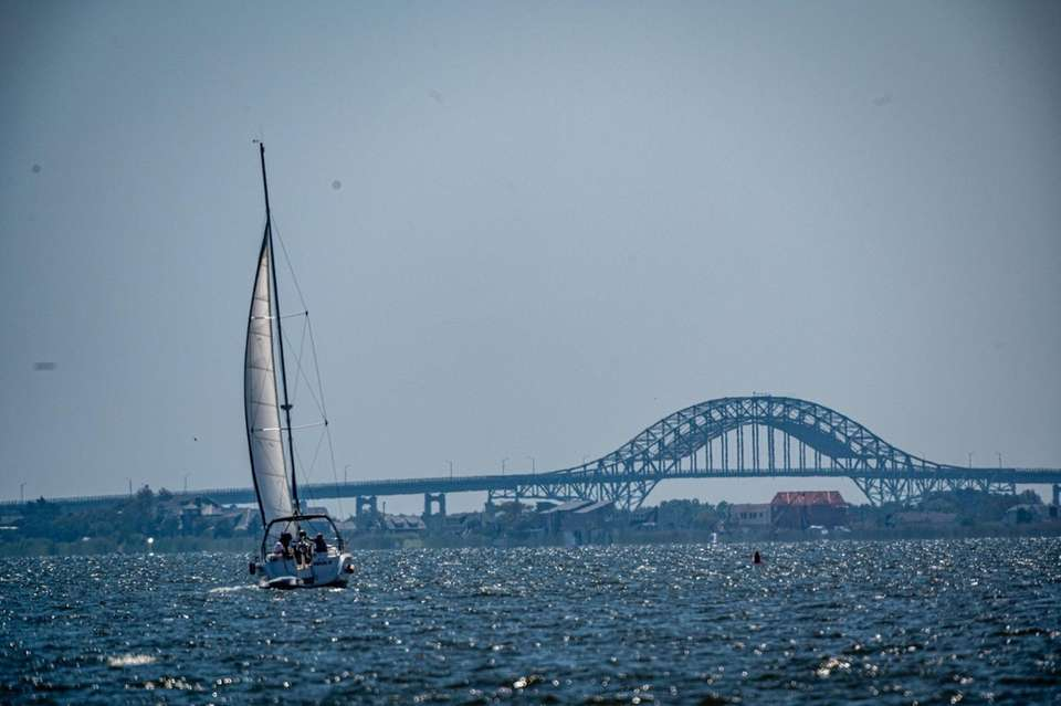 A sail boat slowly moving towards the open