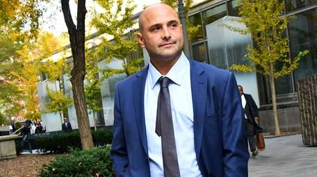 Craig Carton leaves federal court in Manhattan after