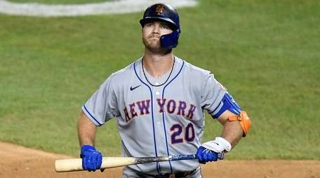 Pete Alonso of the Mets reacts after striking