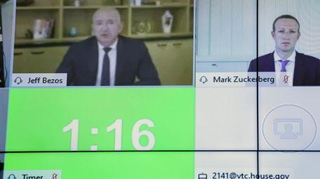 Amazon CEO Jeff Bezos, left, and Facebook CEO
