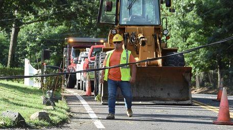 Work crews on scene clearing trees as utilitiy