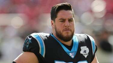 Panthers offensive guard Greg Van Roten warms