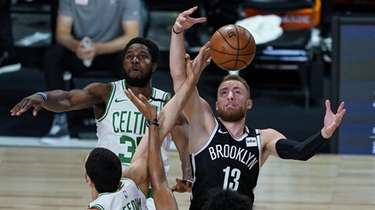 Dzanan Musa #13 of the Brooklyn Nets grabs