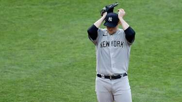 Yankees starting pitcher Jordan Montgomery adjusts his cap