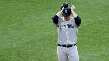 Yankees starting pitcher Jordan Montgomery adjusts his cap