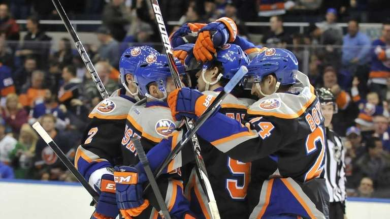 John Tavares, center, is mobbed by his Islanders