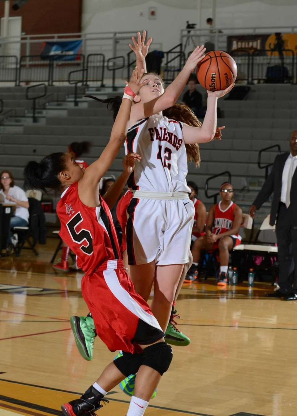 Friend's Rose Mangiarotti goes up for the layup