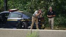 Investigators on the shoulder of the Wantagh State