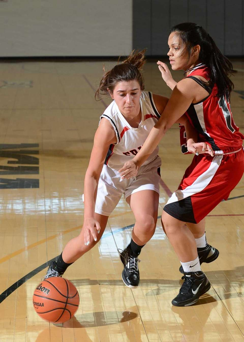 Friend's Madeline O'Brien (left) drives hard to the