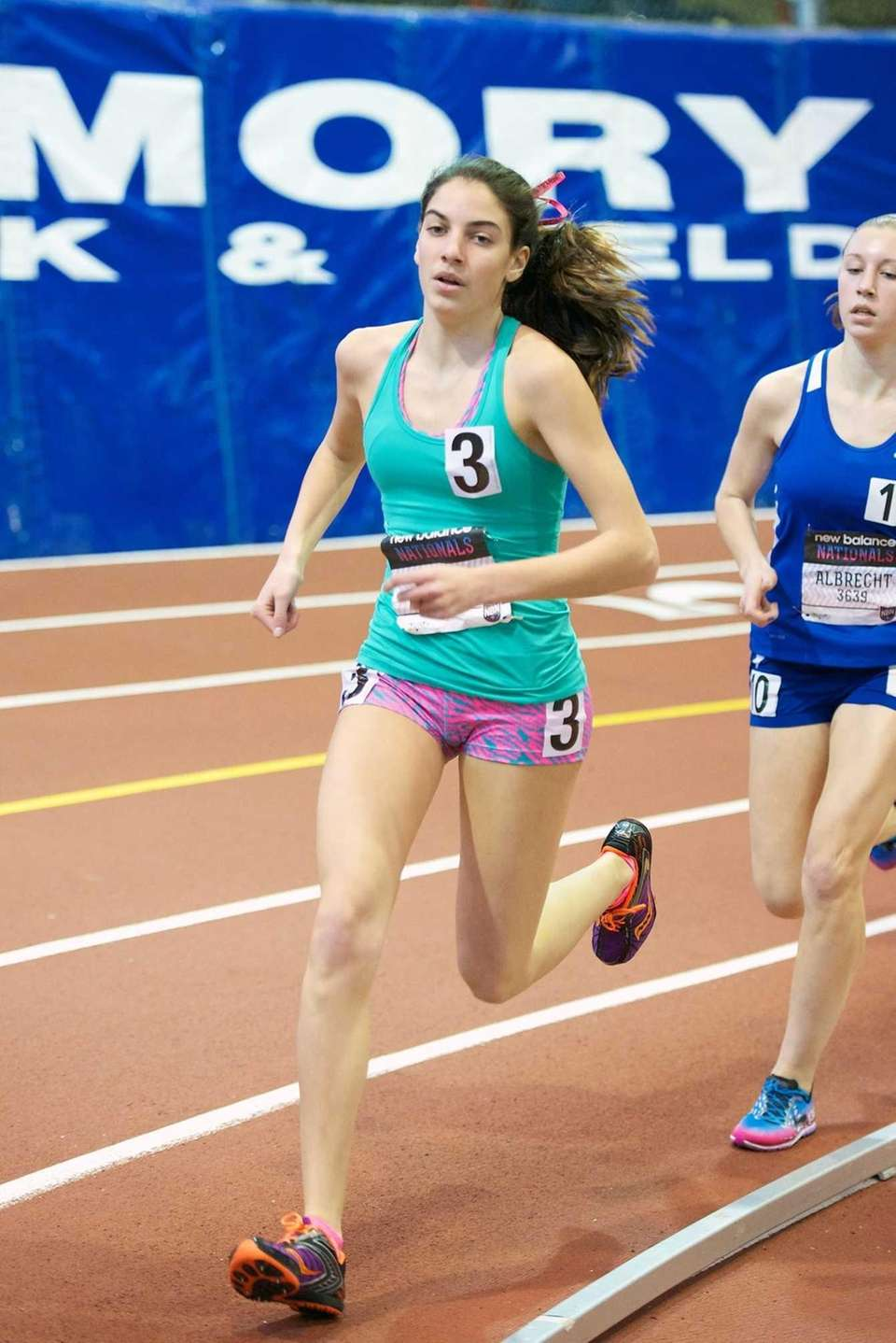Paige Duca of Sacred Heart runs in the