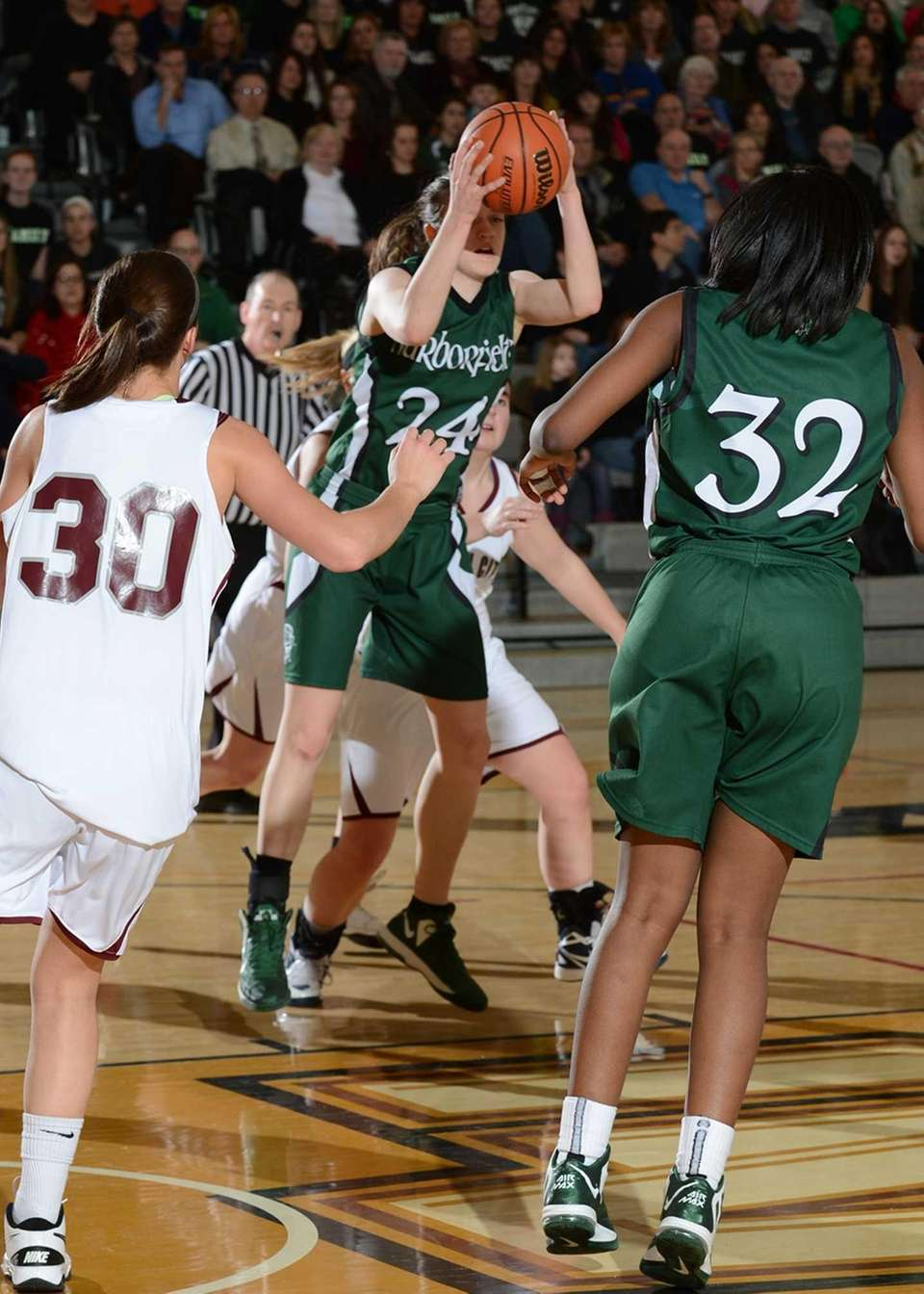 Harborfield's Bridget Ryan (24) gets the rebound during
