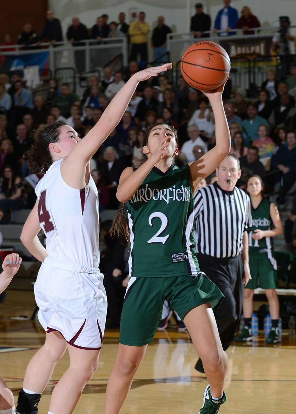 Harborfield's Amy Luxemberg goes up for the layup