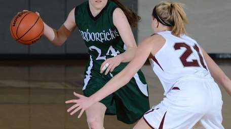 Harborfield's Bridget Ryan brings the ball up during