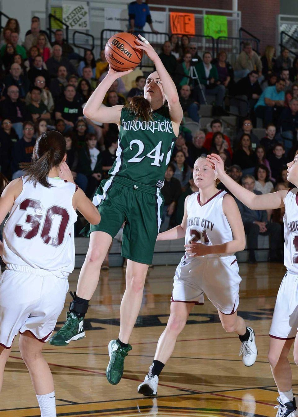 Harborfield's Bridget Ryan goes up for the jump