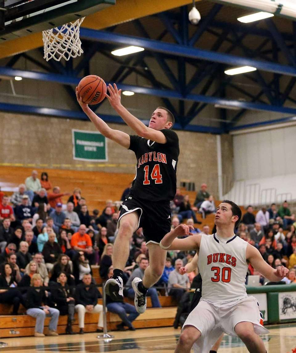 Babylon's Jacob Carlock puts in the layup as