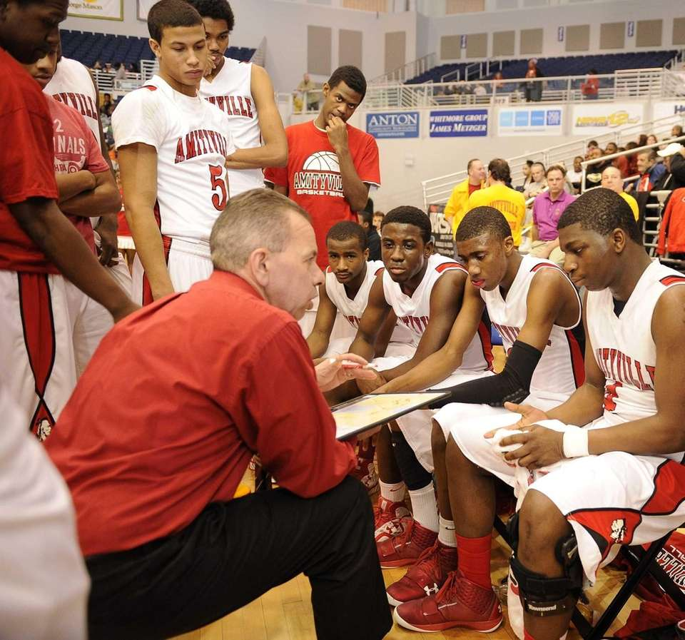 Amityville head coach Jack Agostino speaks to his