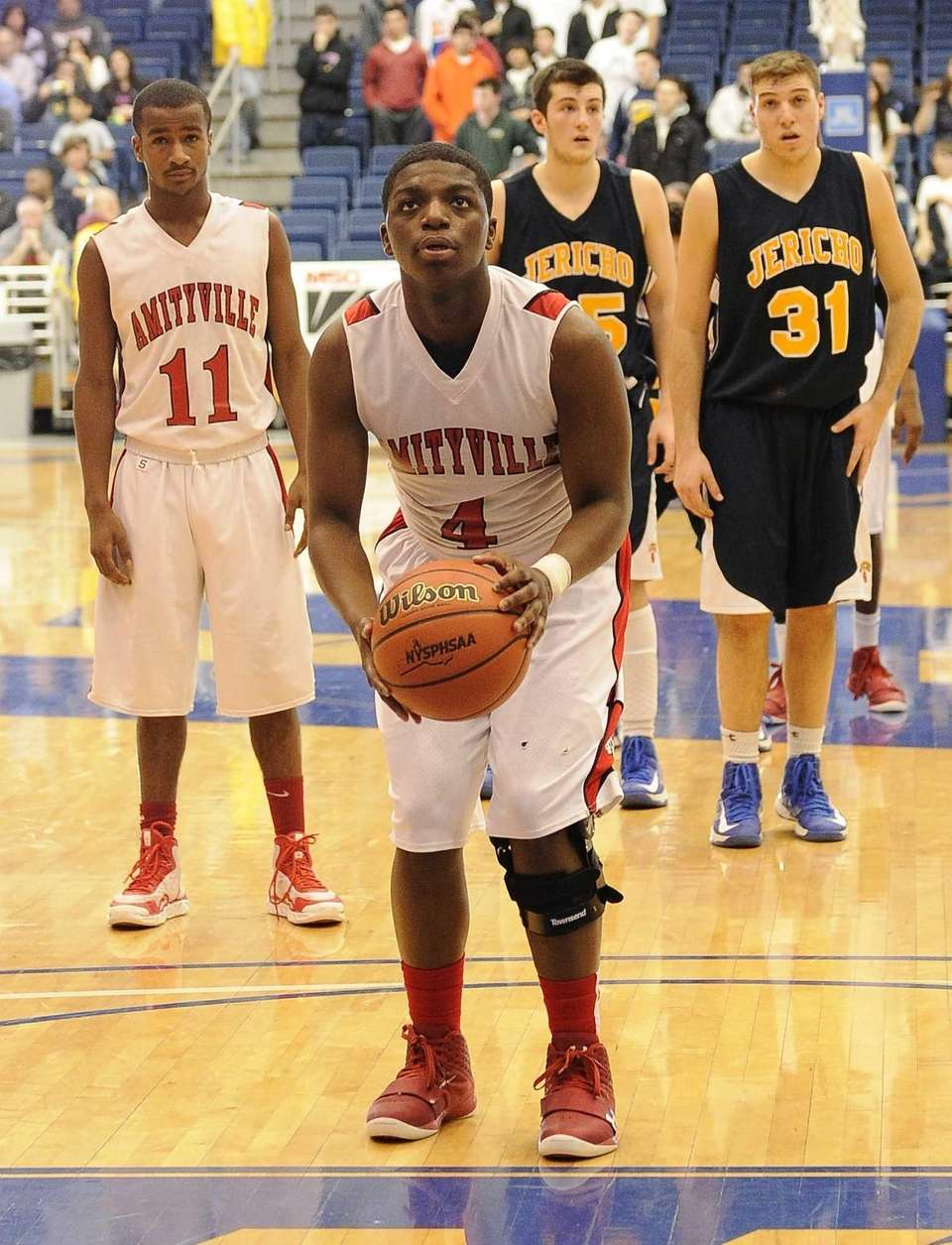 Amityville's Mike Alston shoots from the free throw