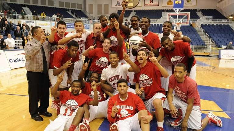 Amityville players and coaches pose with their championship