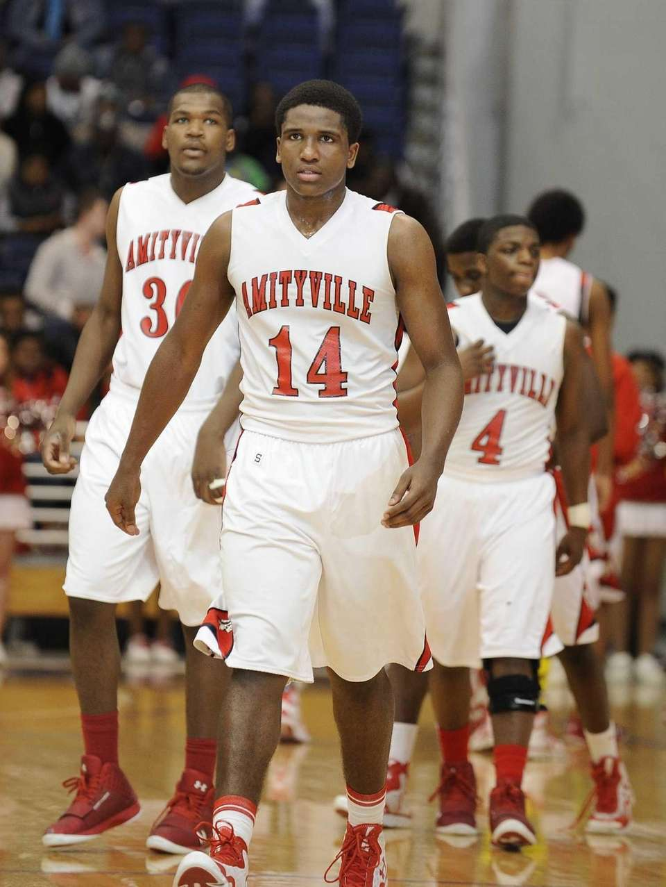 Amityville's Kavione Green leads his team back on
