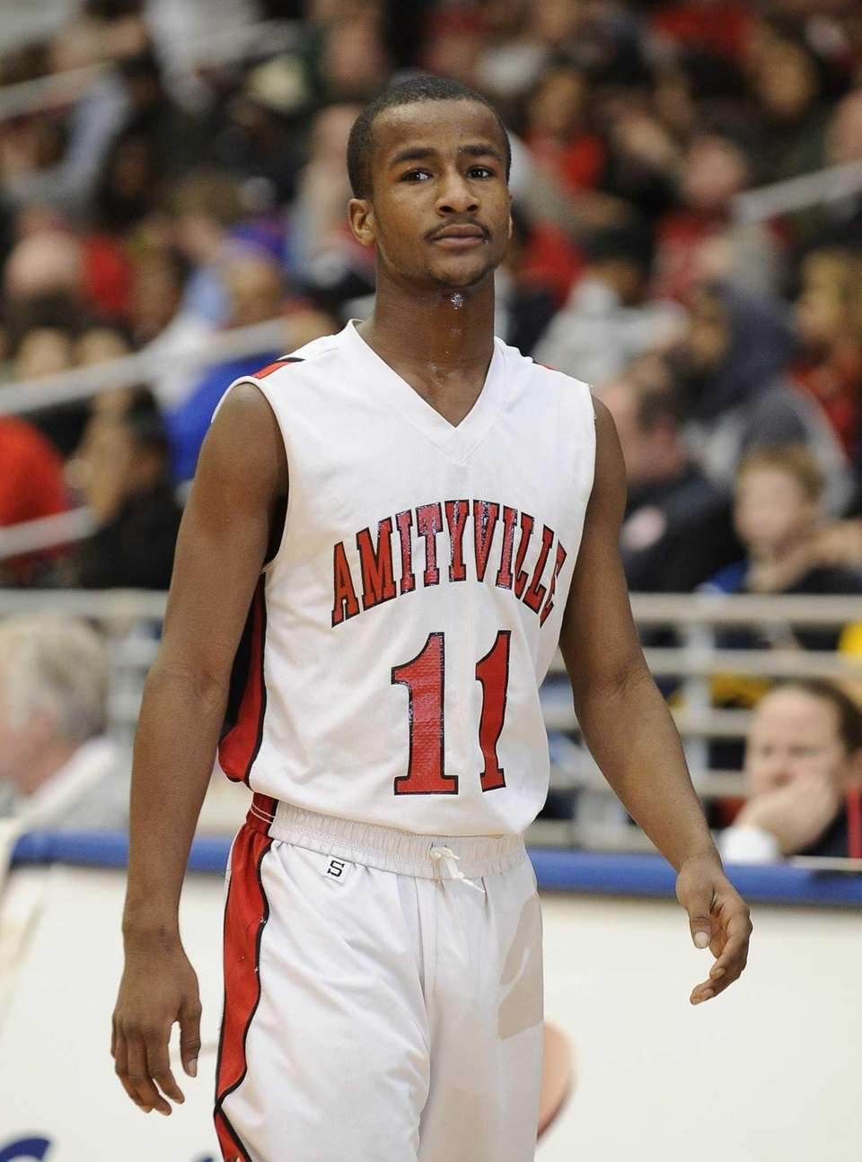 Amityville's Sean Walters on the court during action