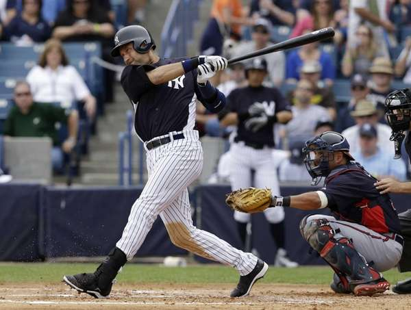 Derek Jeter bats in a spring training game