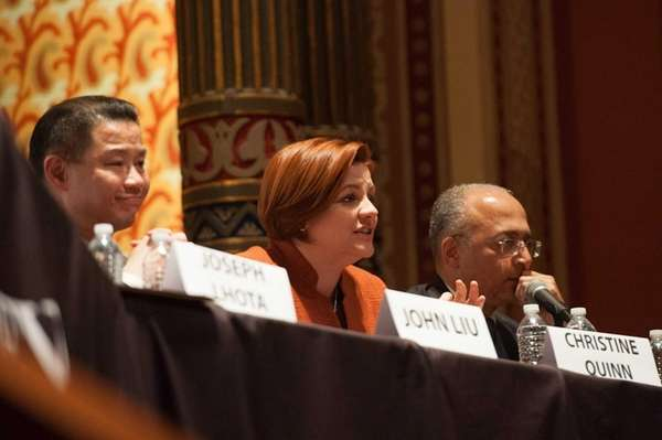 City Council Speaker Christine Quinn, center, answers a